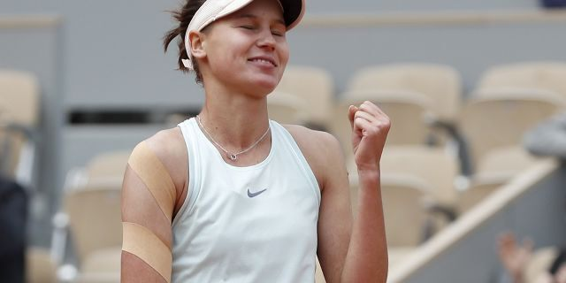 Russia's Veronika Kudermetova celebrates winning against Denmark's Caroline Wozniacki in three sets, 0-6, 6-3, 6-3, during their first round match of the French Open tennis tournament at the Roland Garros stadium in Paris, Monday, May 27, 2019. (AP Photo/Pavel Golovkin)