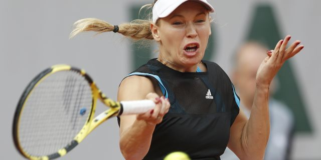 Denmark's Caroline Wozniacki plays a shot against Russia's Veronika Kudermetova during their first round match of the French Open tennis tournament at the Roland Garros stadium in Paris, Monday, May 27, 2019. (AP Photo/Pavel Golovkin)