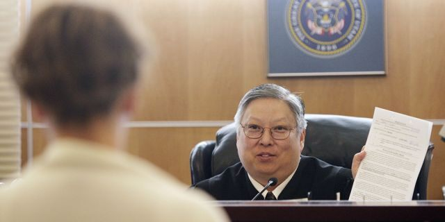 Taylorsville Judge Michael Kwan has been suspended without pay for six months for comments he made online and in court criticizing President Trump.
