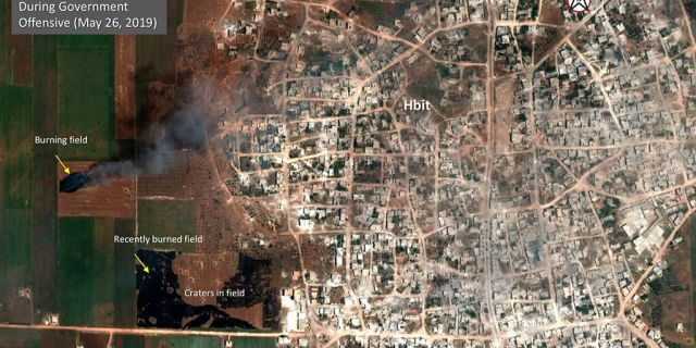 This satellite image provided by Maxar Technologies on Tuesday, May 28, 2019 shows significant damage to Habeet, Syria on May 26 as a result of a government offensive against the last rebel stronghold in the country. The images, provided to the Associated Press by the Colorado-based Maxar Technologies show fire still raging in olive groves and orchards during harvest season around Kfar Nabudah and Habeet, two villages on the edge of Idlib province where fighting has focused.