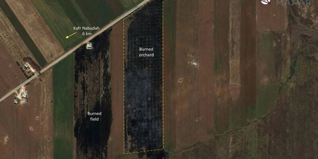 This satellite image provided by Maxar Technologies on Tuesday, May 28, 2019 shows significant damage to fields and orchards south of Kfar Nabudah, Syria, on May 26 as a result of a government offensive against the last rebel stronghold in the country.