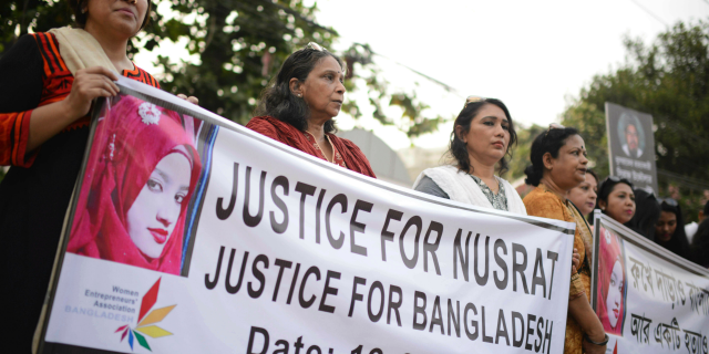 Protesters hold placards and gathered to demand justice for Nusrat Jahan Rafiwho was allegedly killed after she was set on fire for refusing to drop sexual harassment charges against her Islamic school's principal, in Dhaka, Bangladesh, Friday, April 19, 2019.