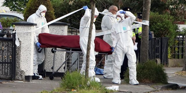 A body, believed to be Sanambar's, is loaded into an ambulance at Kilbarron Avenue where a man was shot dead on Tuesday. (Collins Agency)