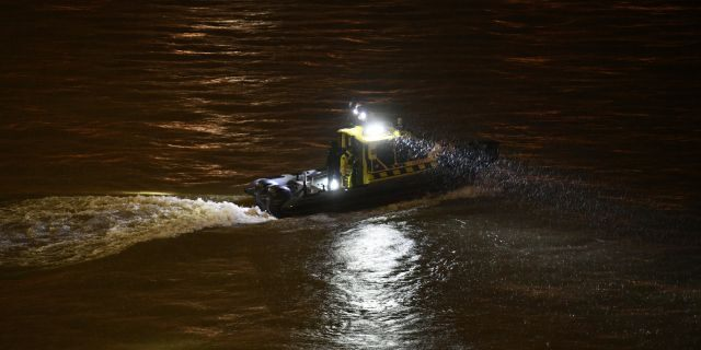 A rescue boat searching for victims Wednesday night. (Zsolt Szigetvary/MTI via AP)