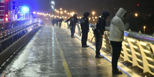 Rescuers and police officers looking at the scene from a landing dock in Budapest. (Zsolt Szigetvary/MTI via AP)