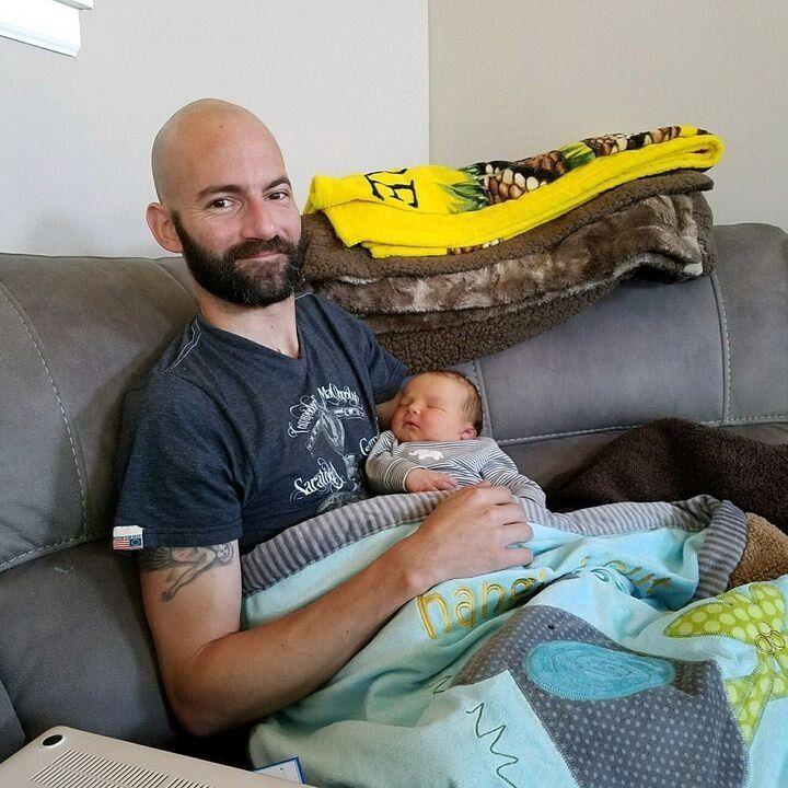 Derek Rotondo with his newborn son Lincoln in 2017.
