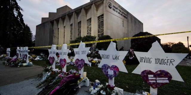A makeshift memorial stands outside the Tree of Life Synagogue in the aftermath of a deadly shooting in Pittsburgh, Pennsylvania, on Oct. 29, 2018. Matt Rourke / AP