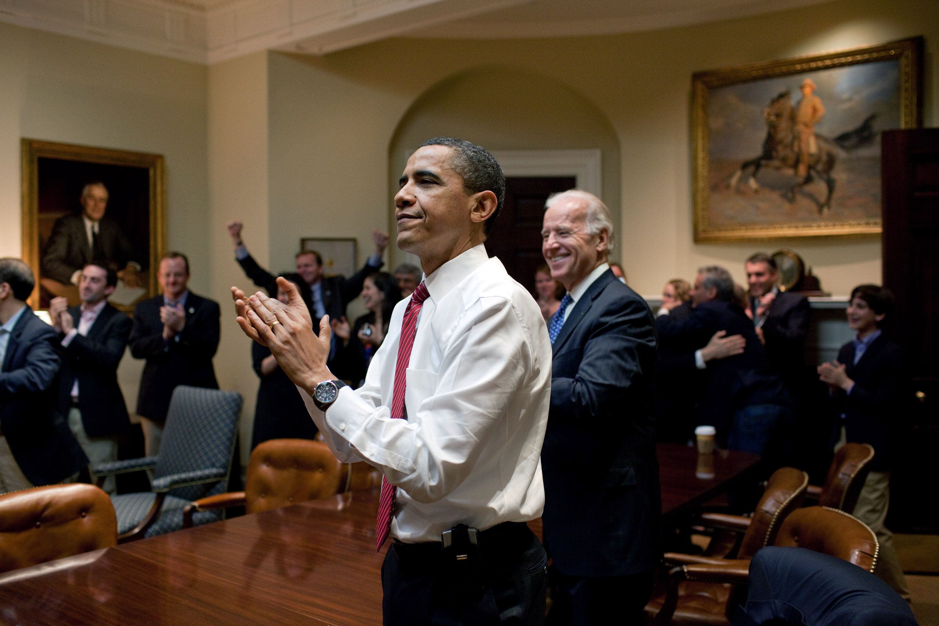 Obama and Biden in the Roosevelt Room, celebrating the Affordable Care Act's passage.