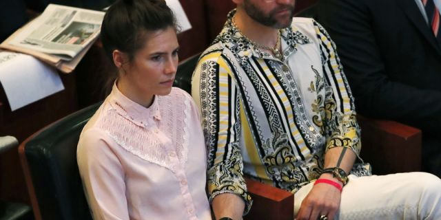 Amanda Knox holds hands with her fiancee Christopher Robinson as they attend a conference during a Criminal Justice Festival at the University of Modena, Italy, Friday, June 14, 2019.