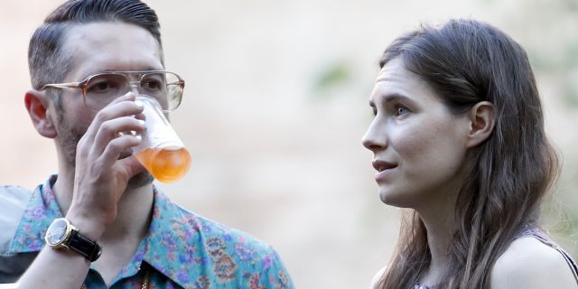 Amanda Knox, right, and her boyfriend Christopher Robinson attend a cocktail for the opening of the Innocence Project conference, in Modena, Italy, Thursday, June 13, 2019.