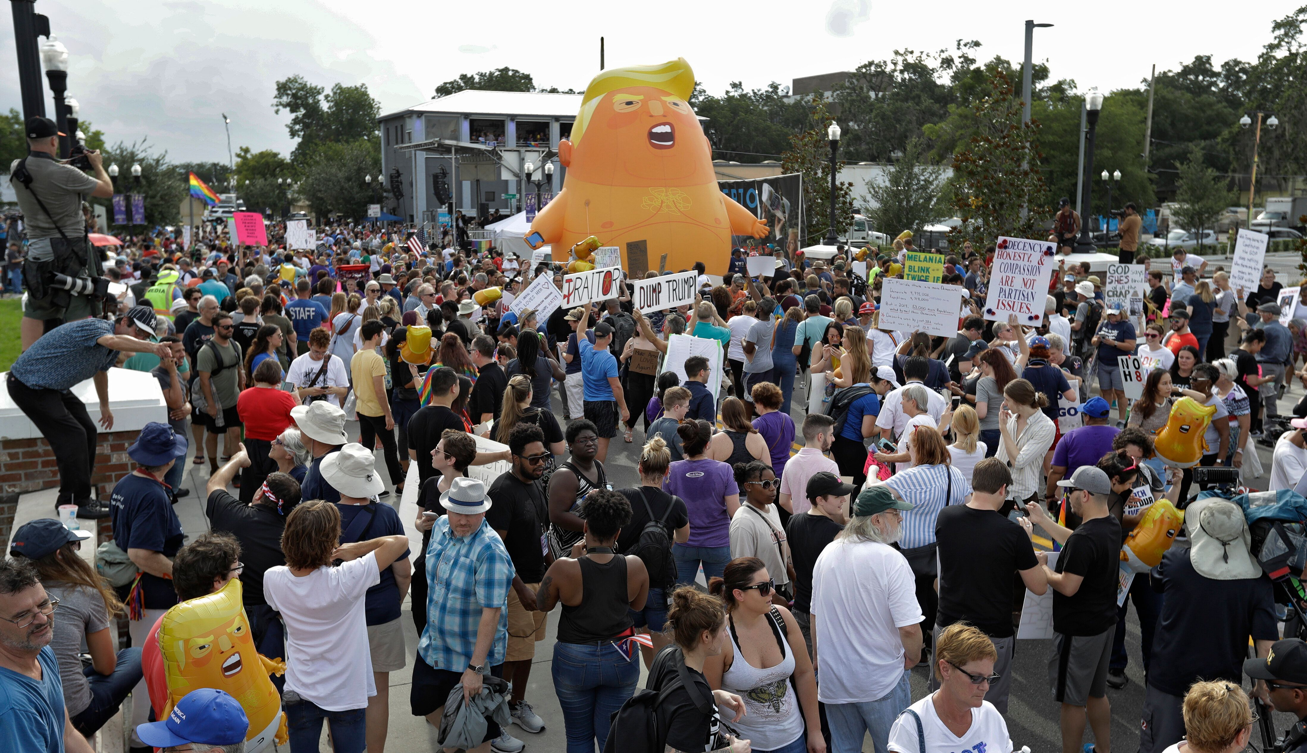 An inflatable Baby Trump balloon towered over protesters during a rally Tuesday, June 18, in Orlando, Florida. A large group
