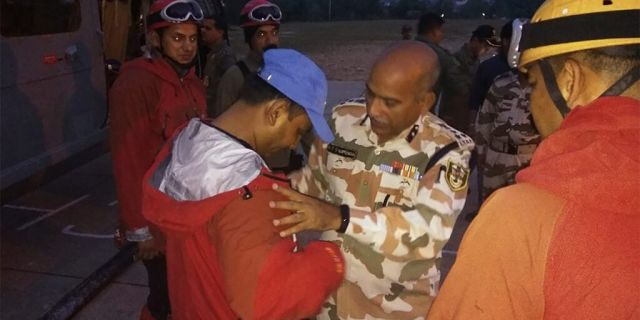 A senior officer sending off soldiers who left to find the climbers in Pithoragarh, India, earlier this month.