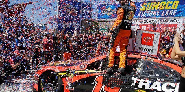 Martin Truex Jr. celebrates after winning a NASCAR Sprint Cup Series auto race Sunday, June 23, 2019, in Sonoma, Calif. (AP Photo/Ben Margot)