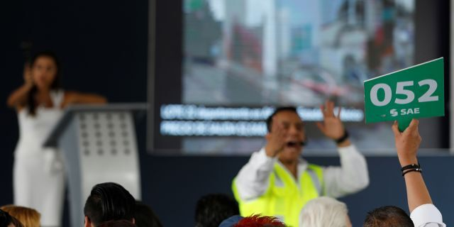 A man bids during an auction of seized properties from drug traffickers and others, in Mexico City, Mexico June 23, 2019.