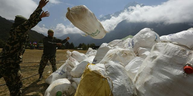 In this May 2019 photo, Nepalese army men pile up the garbage collected from Mount Everest in Namche Bajar, Solukhumbu district, Nepal. (AP)