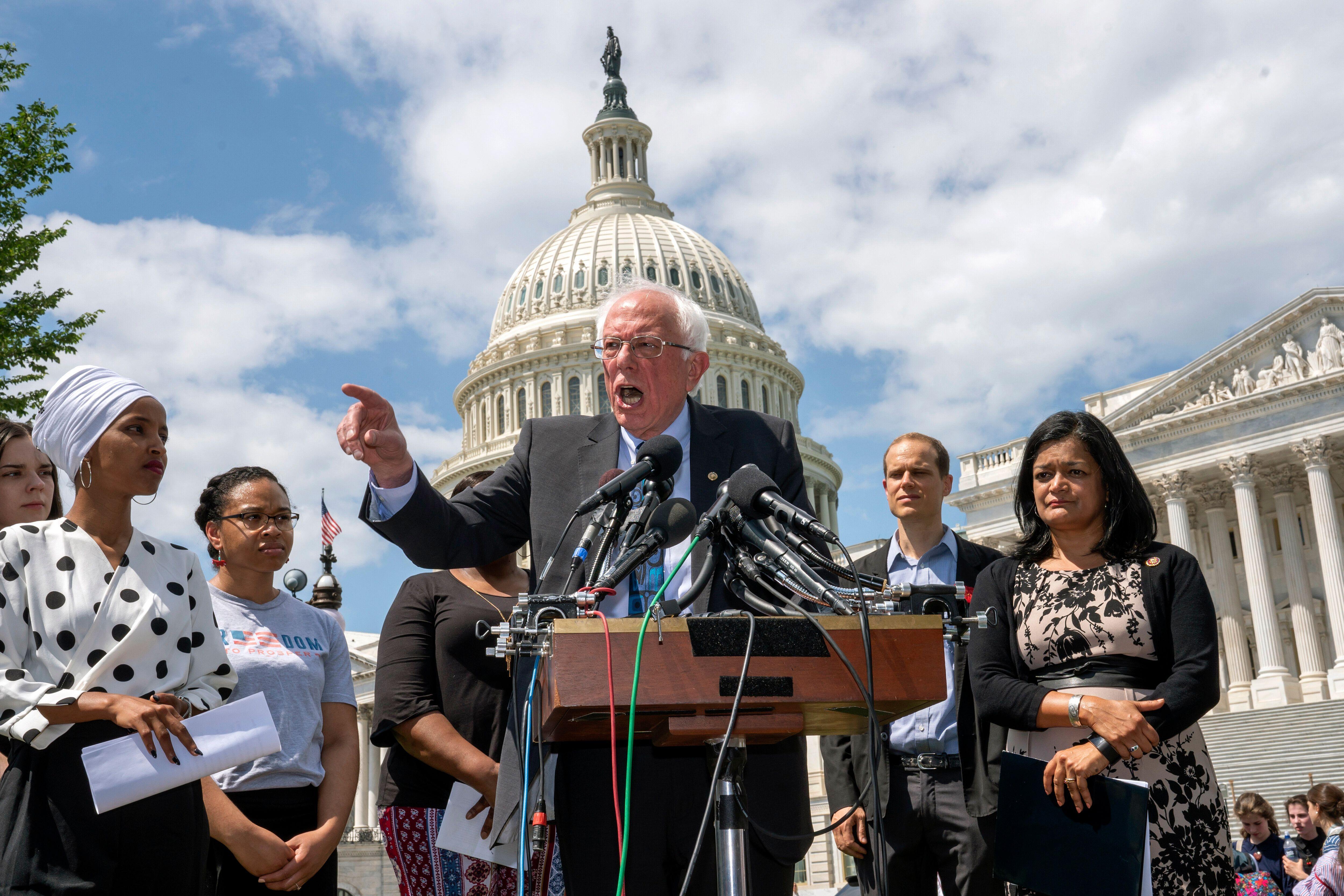 Democratic presidential candidate Bernie Sanders, flanked Monday by Rep. Ilhan Omar (D-Minn.), left, and Rep. Pramila Jayapal