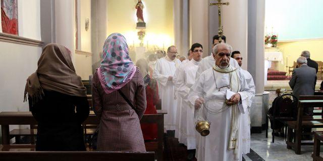 Tehran, Iran: Christian pilgrims attend a mass led by Chaldean Catholic archbishop of Tehran Ramzi Garmou (not seen) during Christmas celebrations at the St. Joseph Catholic Church in Tehran, Iran, on December 25, 2014. (Photo by Fatemeh Bahrami/Anadolu Agency/Getty Images)