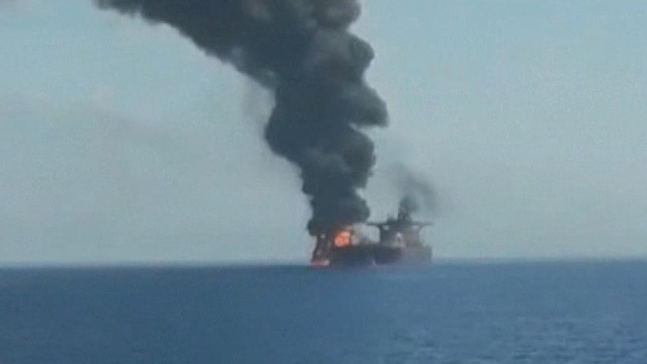 Oil tanker damaged in suspected attack burns in the Gulf of Oman