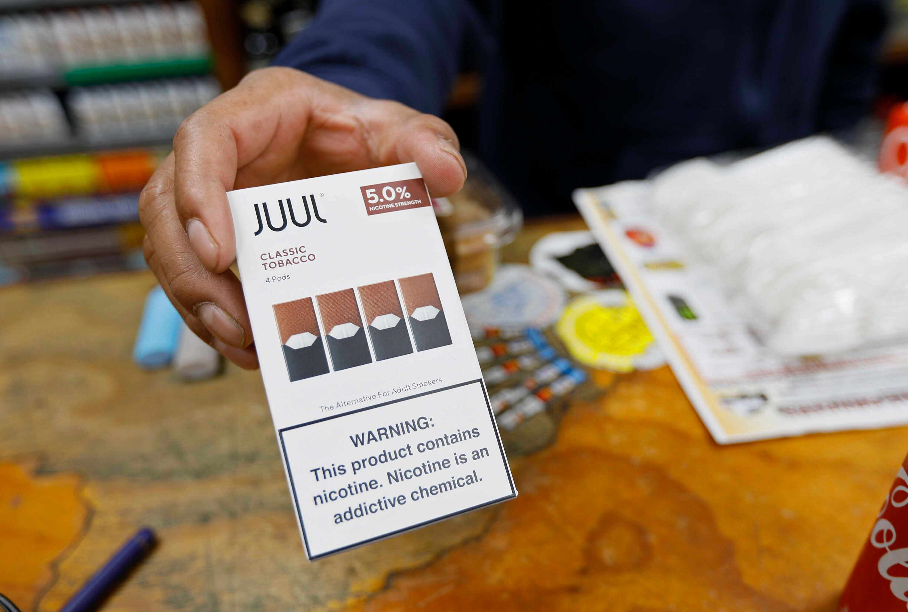 A San Francisco cashier displays a packet of tobacco-flavored Juul pods. San Francisco supervisors voted to ban all sales of