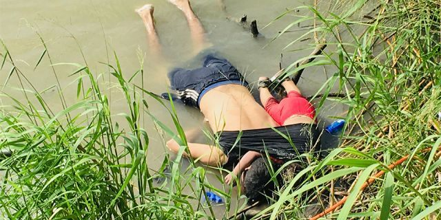 The bodies of Salvadoran migrant Oscar Alberto Martínez Ramírez and his nearly 2-year-old daughter Valeria lie on the bank of the Rio Grande in Matamoros, Mexico, on Monday. (AP)