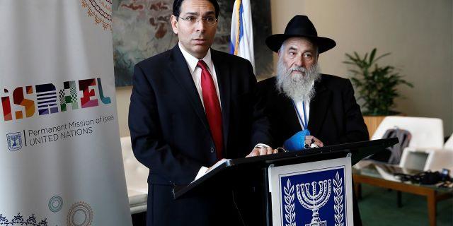 Israeli Ambassador to the United Nations Danny Danon and Rabbi Yisroel Goldstein address reporters Wednesday.(REUTERS/Shannon Stapleton)
