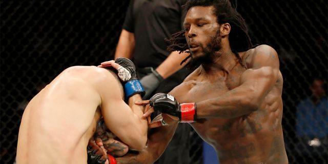 Desmond Green punches Charles Jourdain of Canada during a UFC lightweight bout last month in Rochester, N.Y. (Photo by Michael Owens/Zuffa LLC/Zuffa LLC via Getty Images)