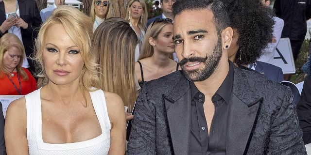 "Pamela Anderson and Adil Rami attend Amber Lounge 2019 Fashion Show on May 24, 2019 in Monte-Carlo, Monaco. The couple, who dated for two years, recently split and Anderson accused the soccer star of cheating and ""physical and emotional torture"" during their relationship."