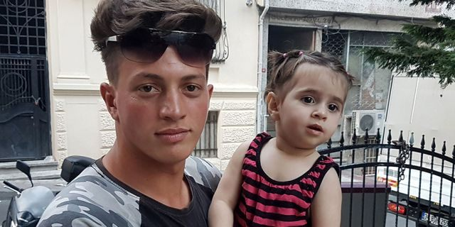 Algerian citizen Fawzi Zabaat (L), 17, poses with Syrian toddler Doha Muhammed he caught as she was falling from the second floor at Fatih district in Istanbul on June 27, 2019. (Photo by STR / DHA / AFP) / Turkey OUT (Photo credit should read STR/AFP/Getty Images)