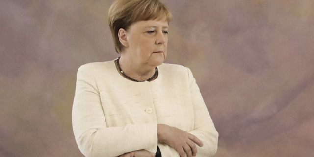 """Angela Merkel was seen shaking at a public event for the second time in less than two weeks. A spokesman on Wednesday dismissed any concerns over her health, saying """"the chancellor is fine."""""""