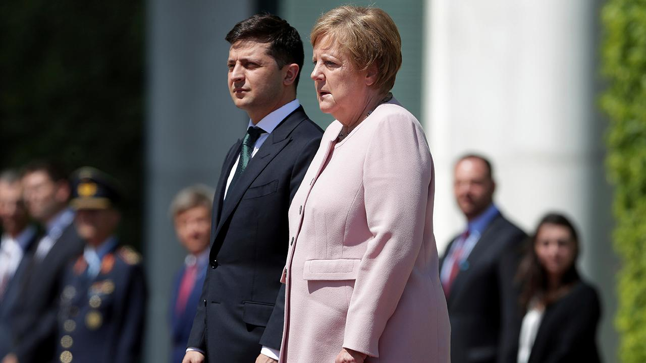 Angela Merkel appears to shake uncontrollably at ceremony with the new Ukrainian president
