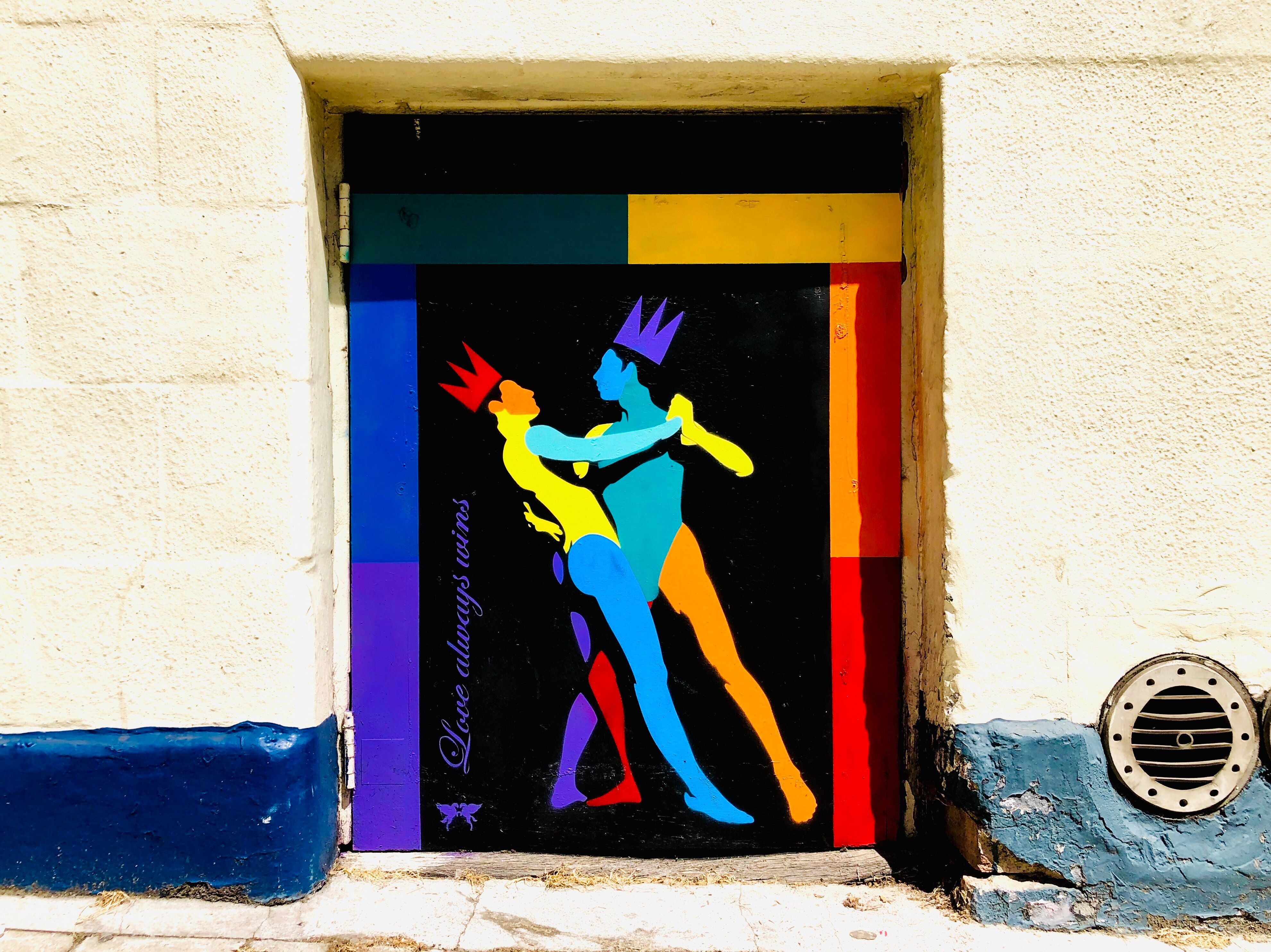 """""""Love Always Wins,"""" painted on the side of The Winchester in Angel, London, by street artist Pegasus, honors Pride Month and"""