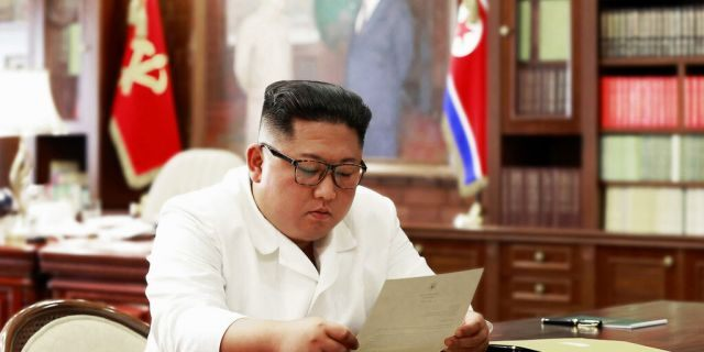 North Korean leader Kim Jong Un reads a letter from U.S. President Donald Trump. (Korean Central News Agency/Korea News Service via AP, File)