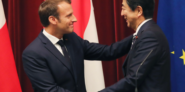 French President Emmanuel Macron, left, shakes hands with Japanese Prime Minister Shinzo Abe after their joint press conference at Abe's official residence in Tokyo, Wednesday, June 26, 2019. (AP Photo/Koji Sasahara, pool)