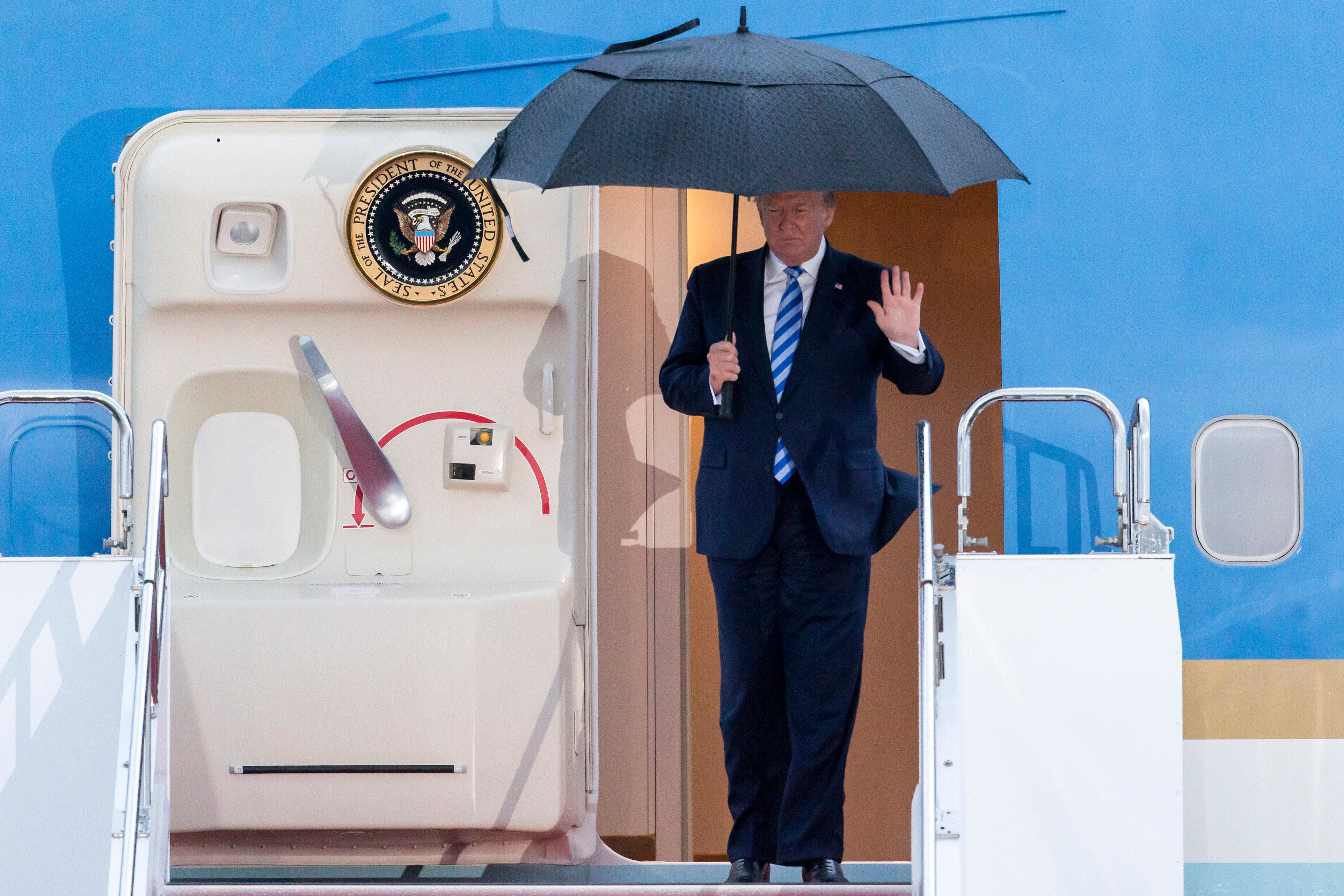 U.S. President Donald Trump waves as he arrives for the G-20 Osaka summit.