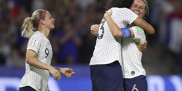 France's Amandine Henry, right, celebrates with France's Wendie Renard, center, and France's Eugenie Le Sommer after scoring her side's 2nd goal during the Women's World Cup round of 16 soccer match between France and Brazil at the Oceane stadium in Le Havre, France, Sunday, June 23, 2019. (AP Photo/Francisco Seco)