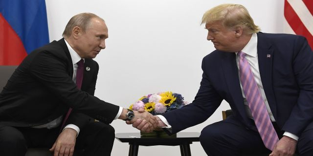 President Donald Trump, right, shakes hands with Russian President Vladimir Putin during a bilateral meeting on the sidelines of the G-20 summit in Osaka, Japan, Friday, June 28, 2019. (AP Photo/Susan Walsh)