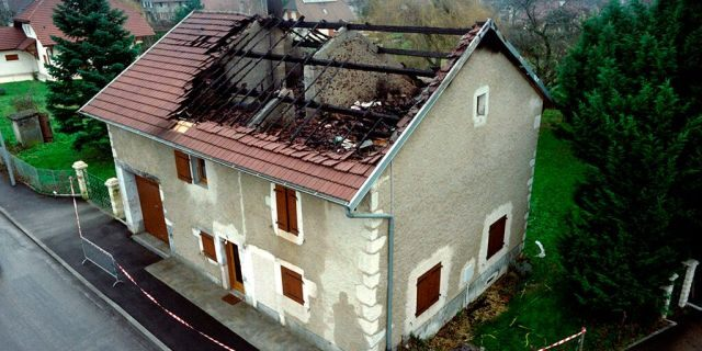 A picture taken on January 12, 1993 shows the burned house of French citizen Jean-Claude Romand in Prévessin-Moëns, where he murdered his wife and two children. - Jean-Claude Romand, sentenced to life in 1996 for the murder of his parents, his wife and children, has filed an application for parole to be examined on September 18, 2018 said judicial source on September 6, 2018. (Photo by Pierre BESSARD / AFP) (Photo credit should read PIERRE BESSARD/AFP/Getty Images)