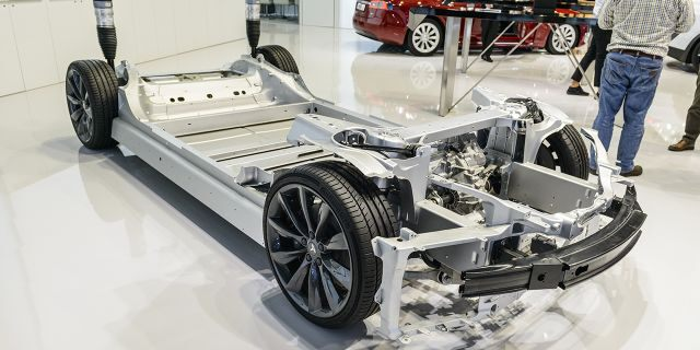 The Model S and X, pictured above, use a floor-mounted battery pack.