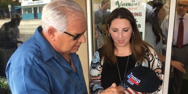 Emilio Izquierdo, a 71-year-old Cuban-American exile, gives his hat to Republican National Committee chairman Ronna McDaniel in Little Havana. (Alex Pappas/Fox News).