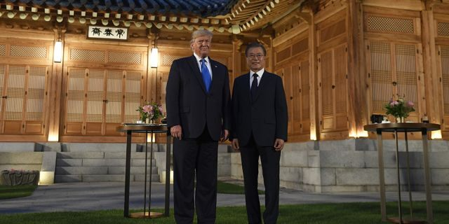 President Donald Trump, left, and South Korean President Moon Jae-in, right, pose for a photo during a visit to the tea house on the grounds of the Blue House in Seoul, South Korea, Saturday, June 29, 2019. Trump is making a quick trip to Seoul after attending the G-20 summit in Osaka, Japan.