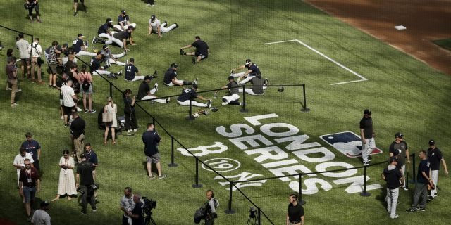 New York Yankees players warm up before a baseball game against the Boston Red Sox on Saturday. Major League Baseball makes its European debut game today at London Stadium.