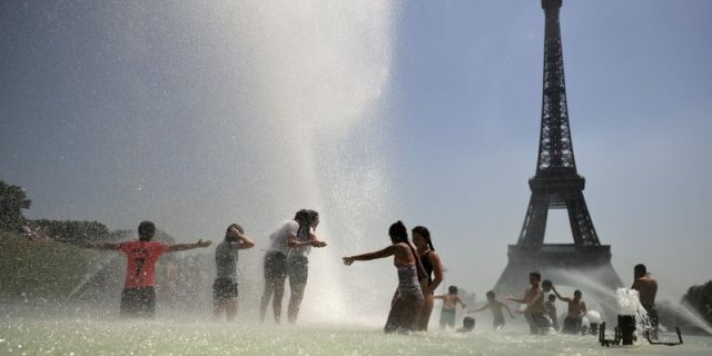 Youngsters cool off at the Trocadero public fountain in Paris, Wednesday, June 26, 2019. High temperatures are expected to go up to 39 degrees Celsius (102 Fahrenheit) in the Paris area later this week and bake much of the country, from the Pyrenees in the southwest to the German border in the northeast.