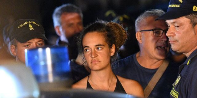 Carola Rackete, the 31-year-old Sea-Watch 3 captain,was escorted off the ship by police and taken away for questioning.