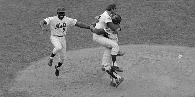 Met third baseman Ed Charles jumps with joy as pitcher Jerry Koosman and catcher Jerry Grote hug each other after the New York Mets downed the Baltimore Orioles, 5-3, in the fifth game of the World Series, Oct. 16, to take the championship title.