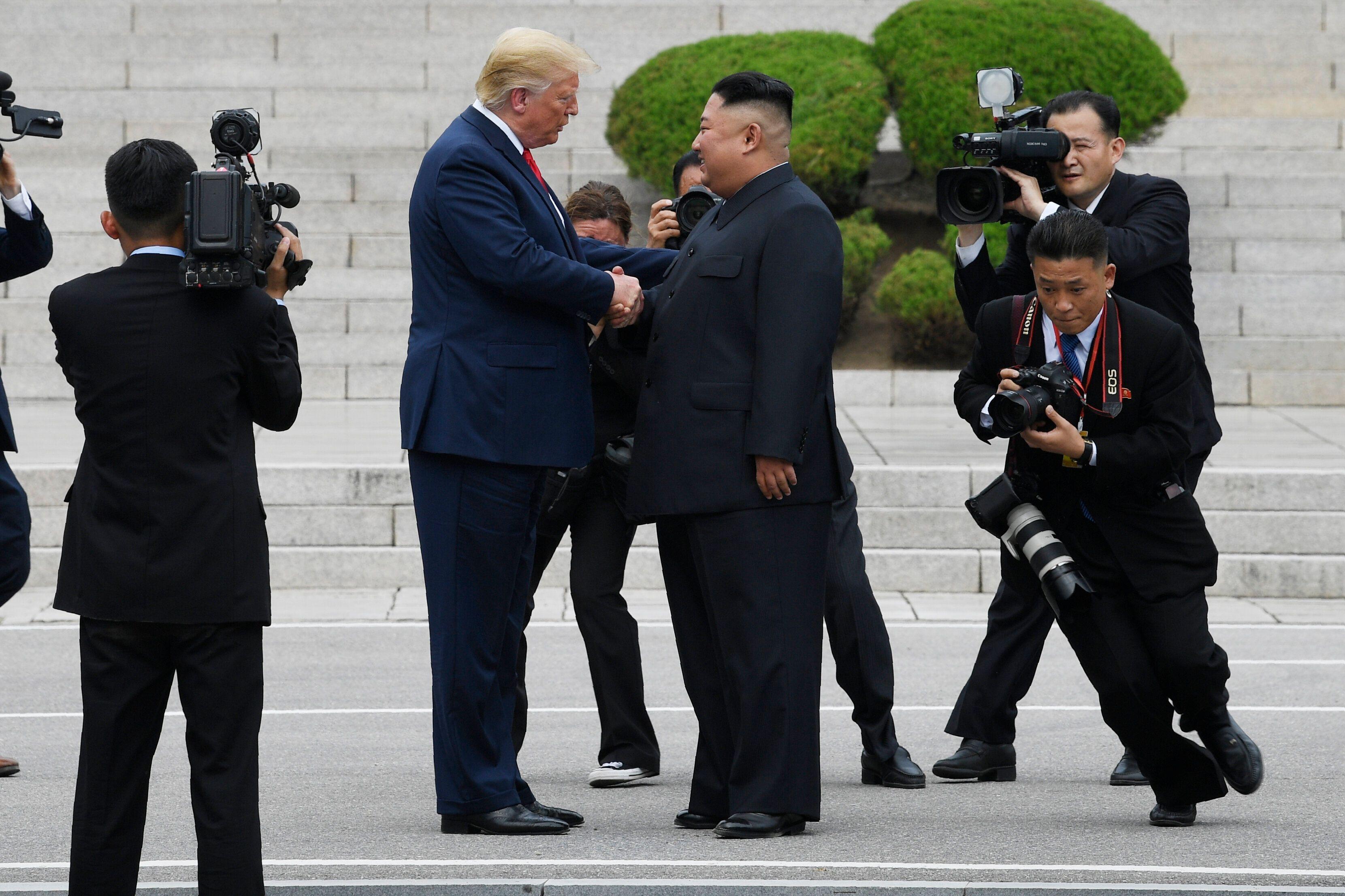 President Donald Trump walks to the North Korean side of the border with North Korean leader Kim Jong Un at the border villag