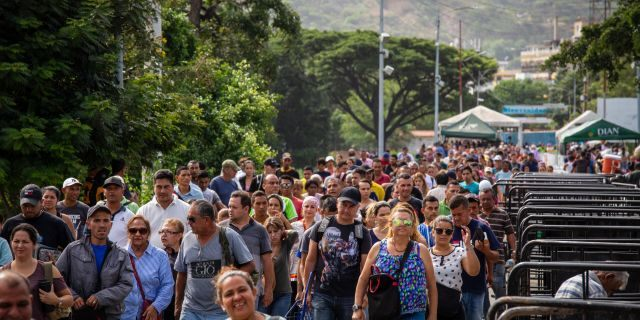 People stream across the Simon Bolivar bridge at the border between Venezuela and Colombia. The border just recently re-opened for all foot traffic. Since then approximately 30,000 people have been coming across each day.