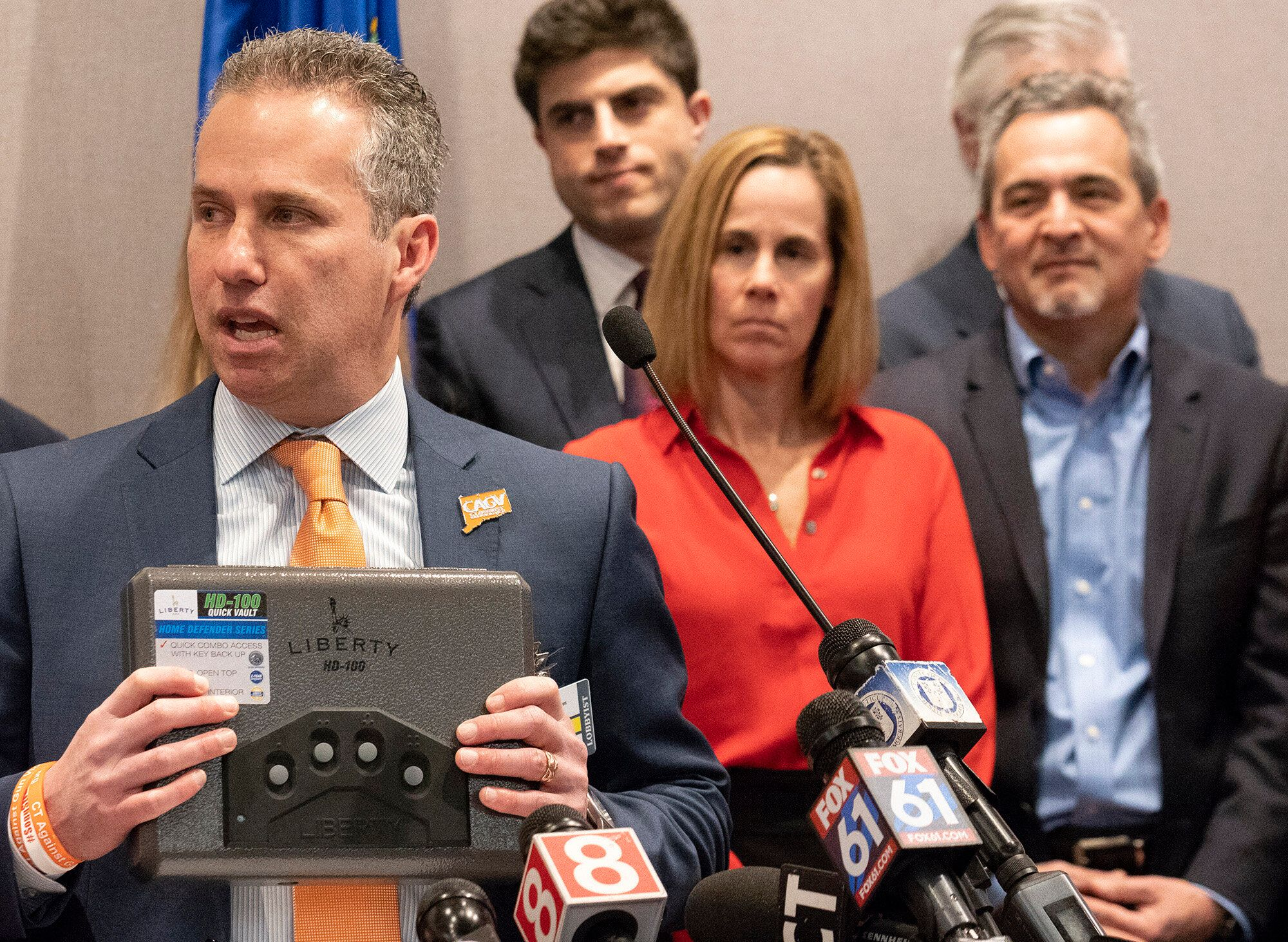 Michael Song, at right, and his wife, Kristen, center, along with legislators and gun-safety advocates, pushed for Connecticu
