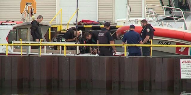A couple from Illinois died while diving in Lake Michigan off the coast of Wisconsin on Friday, according to officials.