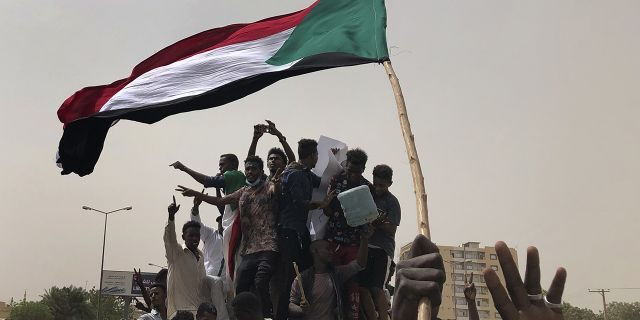 """Mohammed el-Hassan Labat said early Friday, July 5, that both sides agreed to form a joint sovereign council that will rule the country for """"three years or a little more."""" The sides agreed to five seats for the military and five for civilians with an additional seat going to a civilian with a military background. (AP Photo/Hussein Malla, File)"""