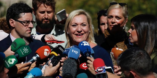 Ines Madrigal speaks to journalists outside a court in Madrid, Spain. A woman who became a crusader for babies abducted during Spain's 20th-century dictatorship said Thursday that she has found her biological family and learned that her mother gave her up voluntarily. (AP Photo/Manu Fernandez, File)